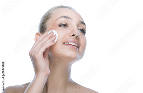 beauty woman face with cotton pad