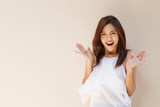 Fototapety happy woman showing exciting positive expression with blank back