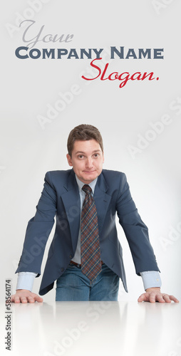 Businessman leaning on a desk