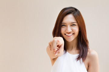 smiling woman point finger at you, positive mood with text space