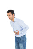 Casual young man with stomach pain