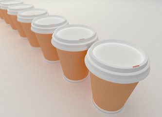 A row of paper coffee cups.