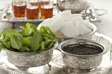 Traditional Moroccan bowls with sugar,mint and tea