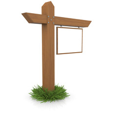 Wooden signboard in the grass