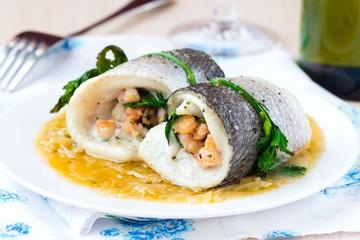 Fish rolls of dorado fillet stuffed shrimp and spinach, onion
