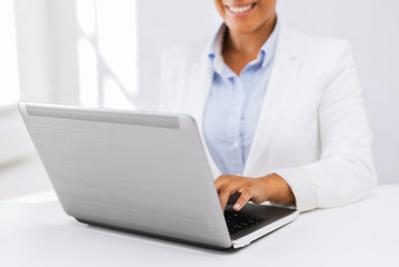 businesswoman using her laptop computer