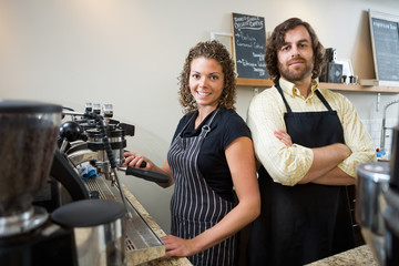 Confident Workers At Counter In Coffeeshop