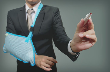 young businessman with broken hand wearing an arm brace, series