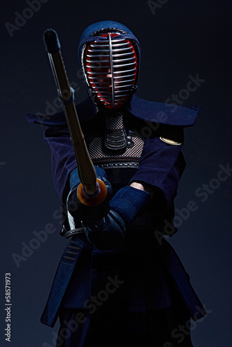 portrait of a kendo fighter with shinai