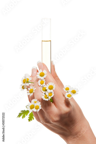 Woman's hand with essential oil