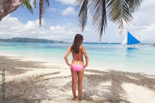 Woman posing on the beach