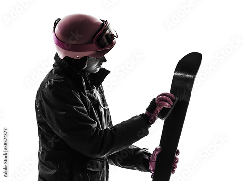 one woman skier polishing ski silhouette