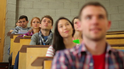 Students listening intently in lecture hall