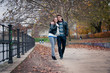 Young love couple walking in the park