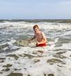 boy enjoys the beautiful ocean and beach