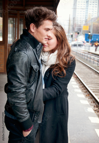 Young love couple waiting on the train stop