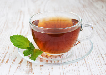 Teacup with mint leaves