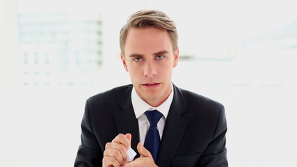 Concentrated annoyed businessman sitting at his desk