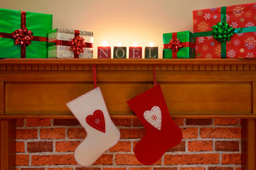 Christmas stockings under the mantlepiece