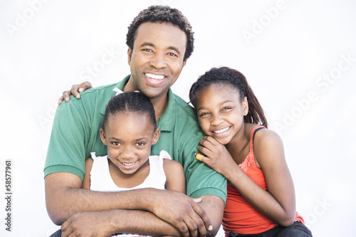 Father spending quality time with daughters on white background