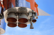 Details of space rocket engine over blue sky background