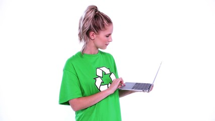 Young blonde environmental activist using her notebook