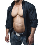 Male bodybuilder in jeans and open shirt revealing pecs and abs poster