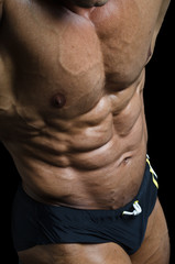 Detail of bodybuilder torso: ripped abs and pecs