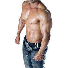 Shirtless male bodybuilder in jeans, really muscular body