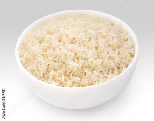 boiled long grain rice in white bowl close-up on white