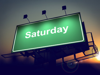 Saturday - Billboard on the Sunrise Background.