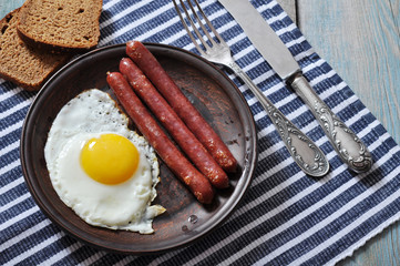 Fried egg with sausages