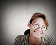 Portrait of a friendly smiling woman with reading glasses