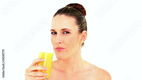 Pretty woman drinking orange juice