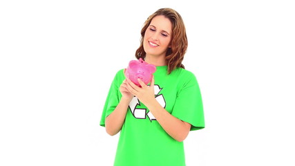 Smiling environmental activist showing piggy bank