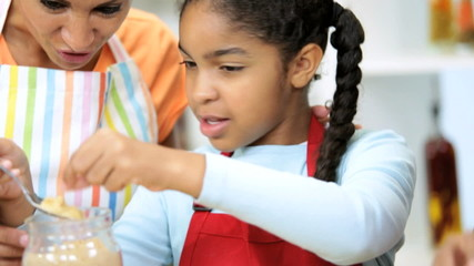 Close Up Little Ethnic Girl Helping Learning Bake Cakes