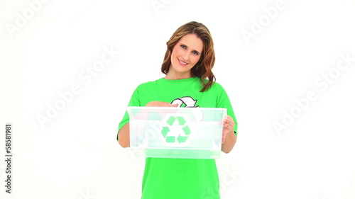 Smiling environmental activist showing empty box