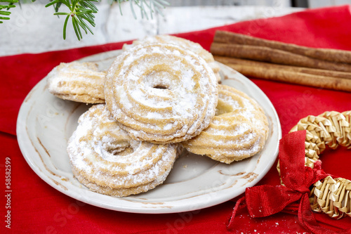 Delightful traditional christmas cookies under fir branch