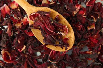 aromatic Hibiscus tea with wooden spoon, close up