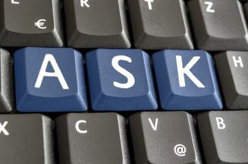 Word Ask spekked on computer keyboard
