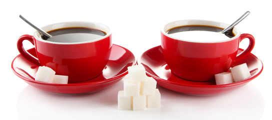 Red cups of strong coffee and sugar isolated on white