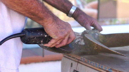 Repairing and sanding a ships propeller