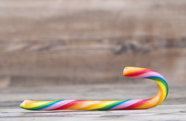 Christmas candy cane on wood texture