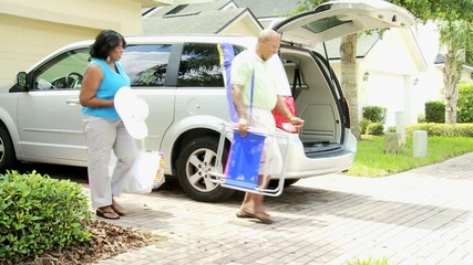 Retired Ethnic Couple Packing Car Beach Outing