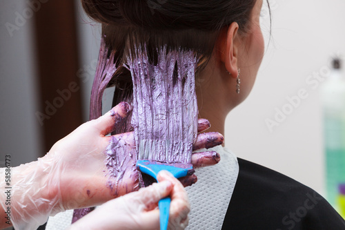 hairdresser applying color customer at salon