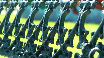 Close Up dolly shot of a metal fence
