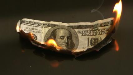 Hundred dollar bill burning
