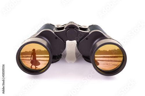 black binoculars and surfer isolated on a white background