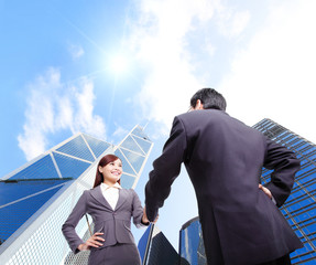 Business woman and man handshake