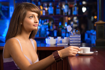 portrait of a nice woman at the bar